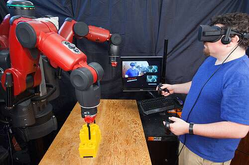 Combining a VR gaming headset and hand controllers with existing robotics control software, CSAIL's new VR system lets users teleoperate a factory robot from up to hundreds of miles away. Source: MIT Computer Science and Artificial Intelligence Lab