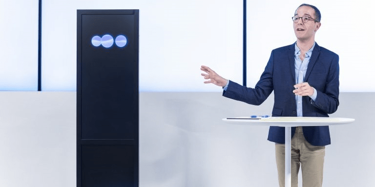 IBM Research AI introduced a Machine Listening Comprehension capability for argumentative content stemming from its work on Project Debater, pictured with professional human debater, Dan Zafrir, in San Francisco. (Photo Credit: IBM Research).