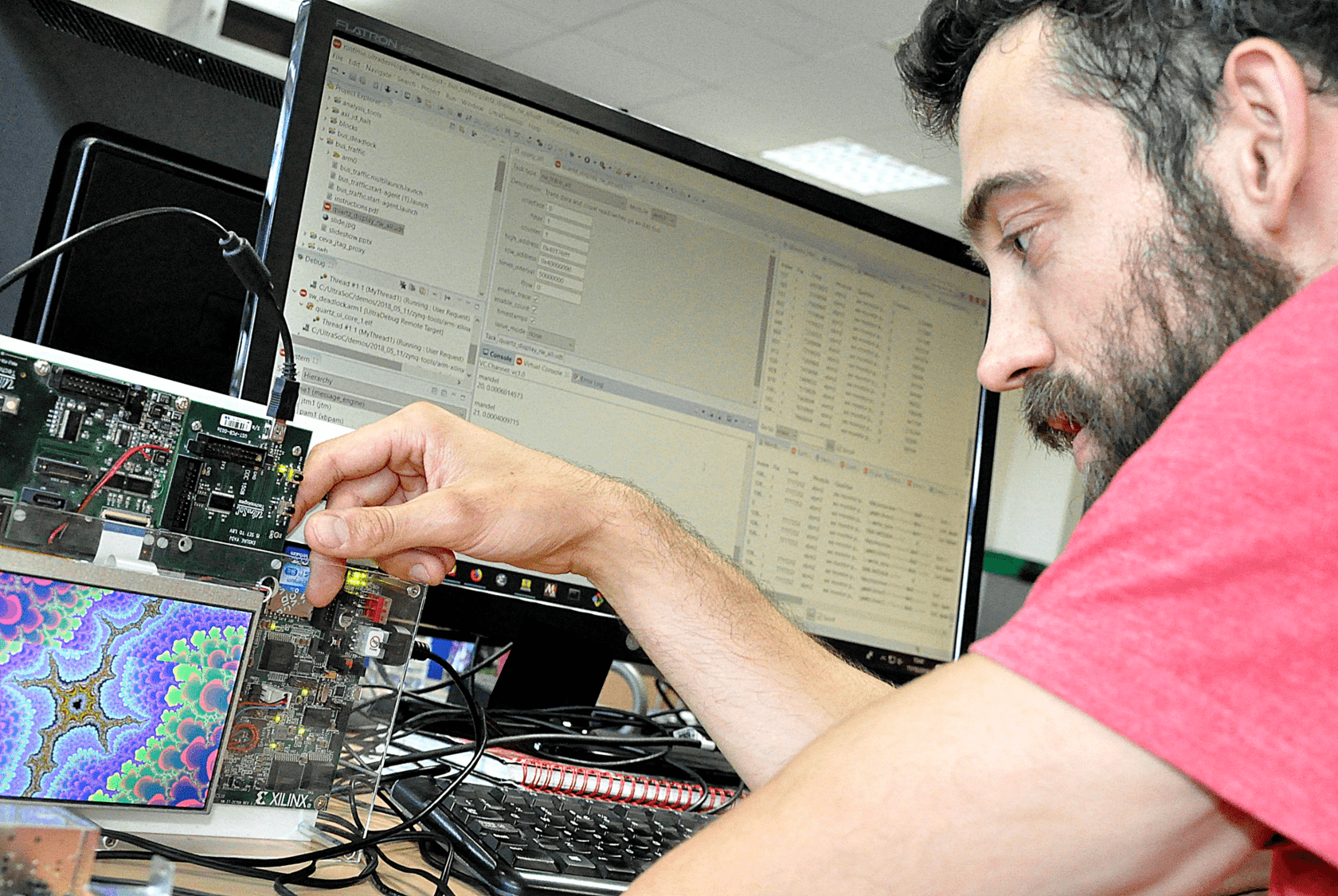 UltraDevelop 2 allows SoC designers to see real-time actionable insights in a single window. In the photo above, a demonstration board containing an Arm CPU generates a fractal pattern on the screen, while the engineer views the operation of the program via the GUI on his workstation. (Photo: UltraSoC)